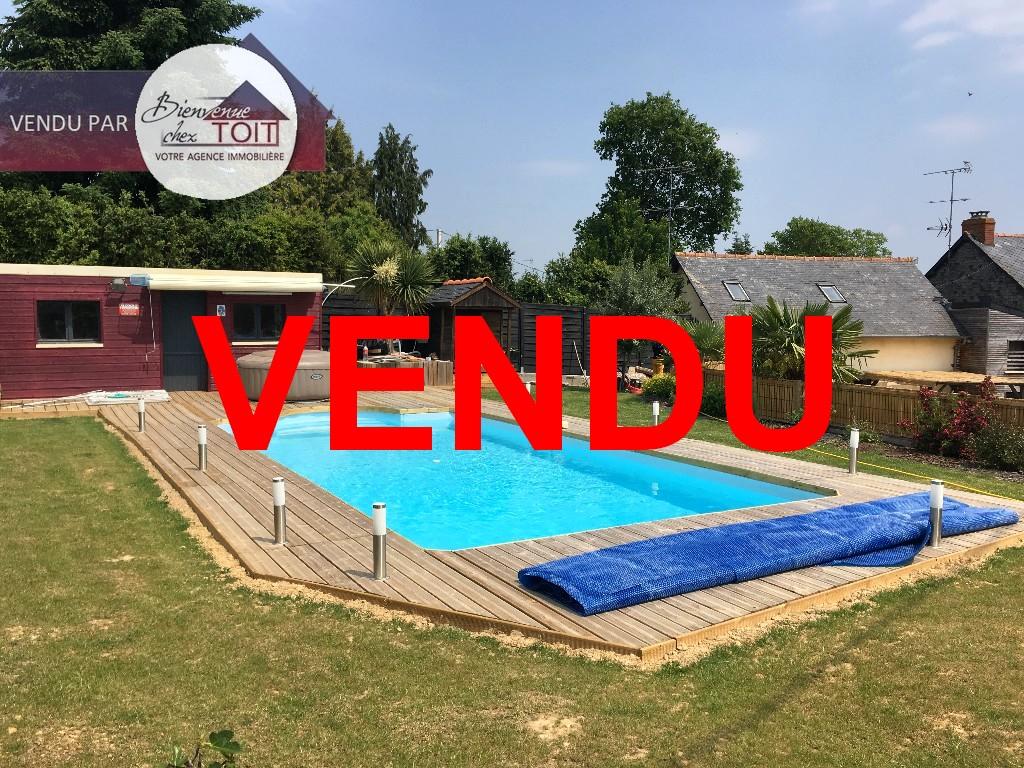 Maison d'environ 100 m² sur un terrain d'environ 550 m² avec piscine chauffée proche Bréal sous Montfort  4 pièce(s)